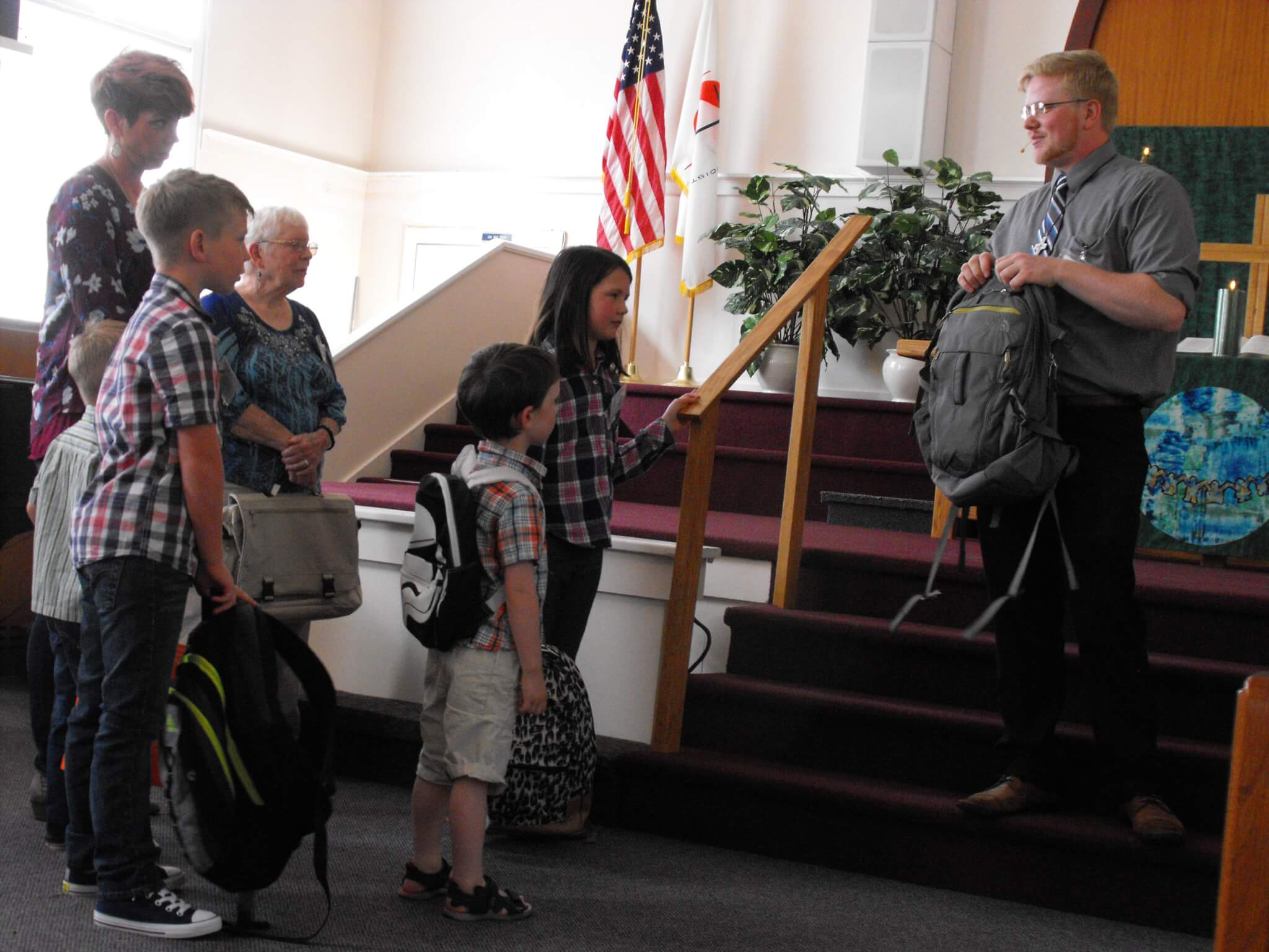 Blessing of backpacks during children's time at Trinity.